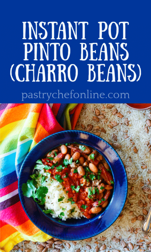 Use your Instant Pot to make a huge recipe of these charro pinto beans. Seasoned with country ham hocks, chipotle, cumin, and cilantro, these Mexican-style Instant Pot cowboy beans make a hearty and flavorful meal. It's also a one of those budget friendly recipes you can make to stretch out meat with filling beans. #pintobeans #charrobeans #cowboybeans #instantpotcomfortfood