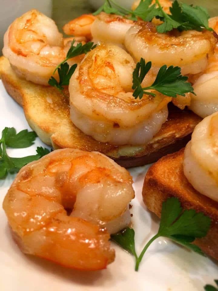 cooked garlic shrimp over toasted white bread