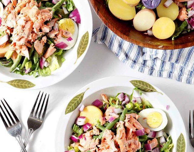 overhead shot of salmon salad on white plates