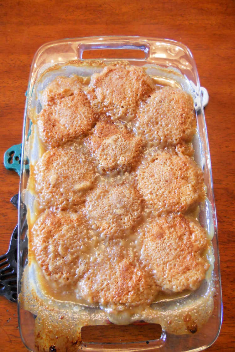 A baked pudding chomeur in a casserole dish, cooling.