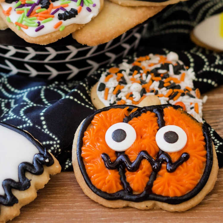 square image of a cookie decorated like a jack o' lantern