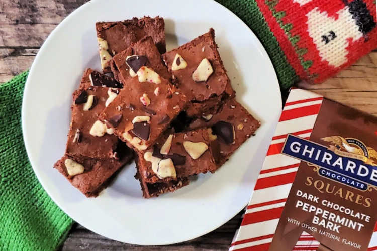 overhead shot of ghirardelli peppermint bark brownies with a bag of dark chocolate peppermint bark