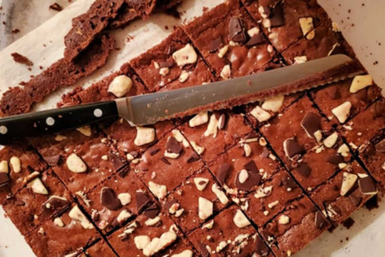 sliced peppermint bark brownies with the edges trimmed off and a serrated knife
