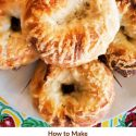 """overhead shot of asiago bagel on plate text reads """"how to make old-school traditionally shaped bagels, chewy on the inside, crackly on the outside"""""""