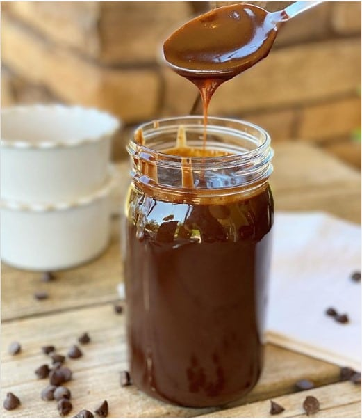 jar of hot fudge sauce with a spoon in it