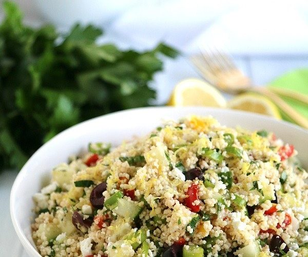 a bowl of mediterranean couscous salad