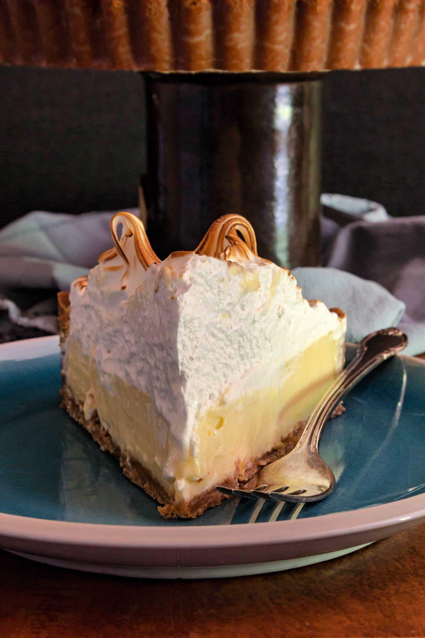 close up of sliced lemon meringue pie