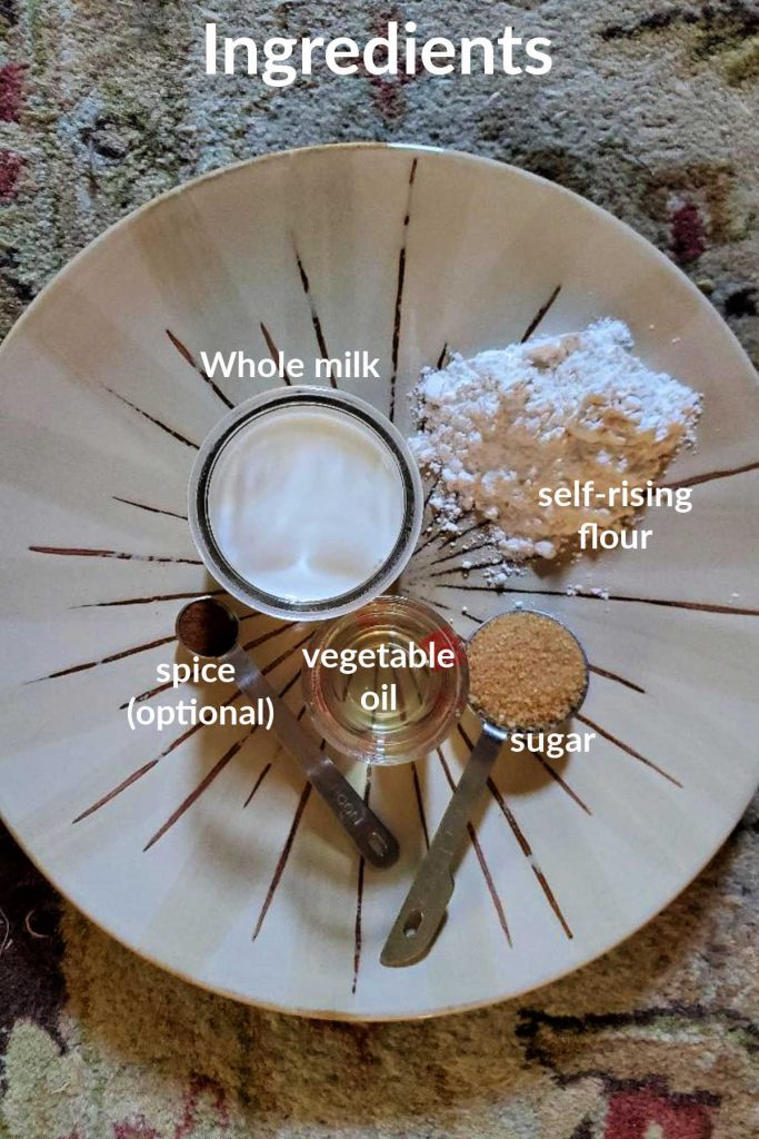 """overhead shot of ingredients for pancakes for one. text reads """"ingredients whole milk, self-rising flour, sugar, vegetable oil, spice (optional)"""""""