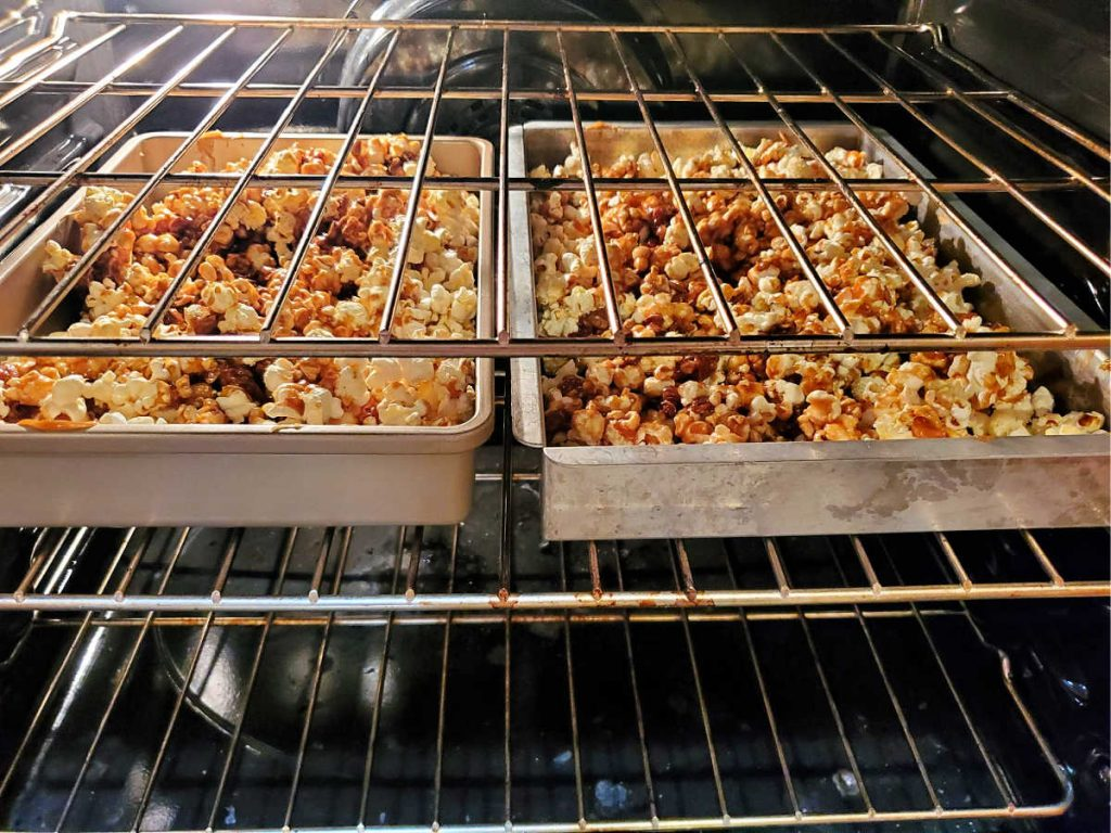 2 pans of caramel popcorn in the oven