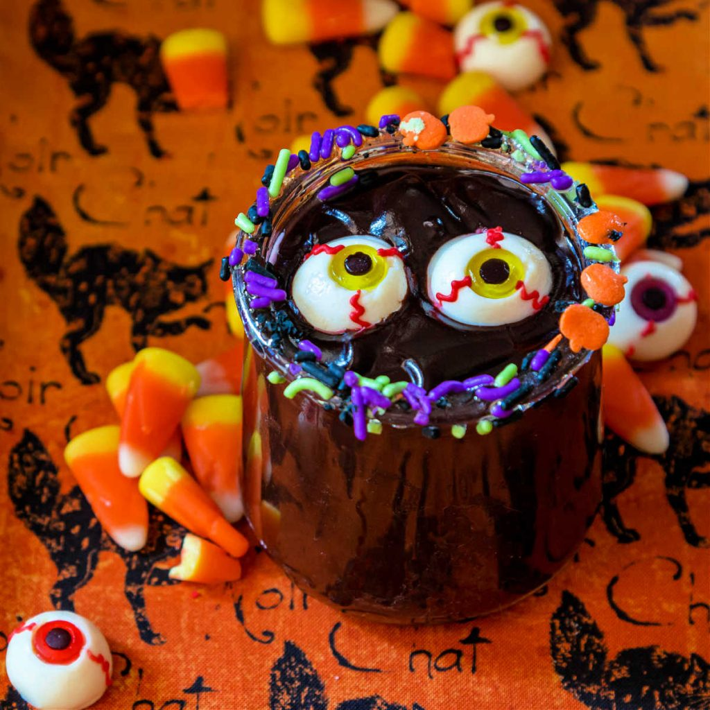 close up of easy chocolate pudding in a dish with Halloween sprinkles and candy eyes