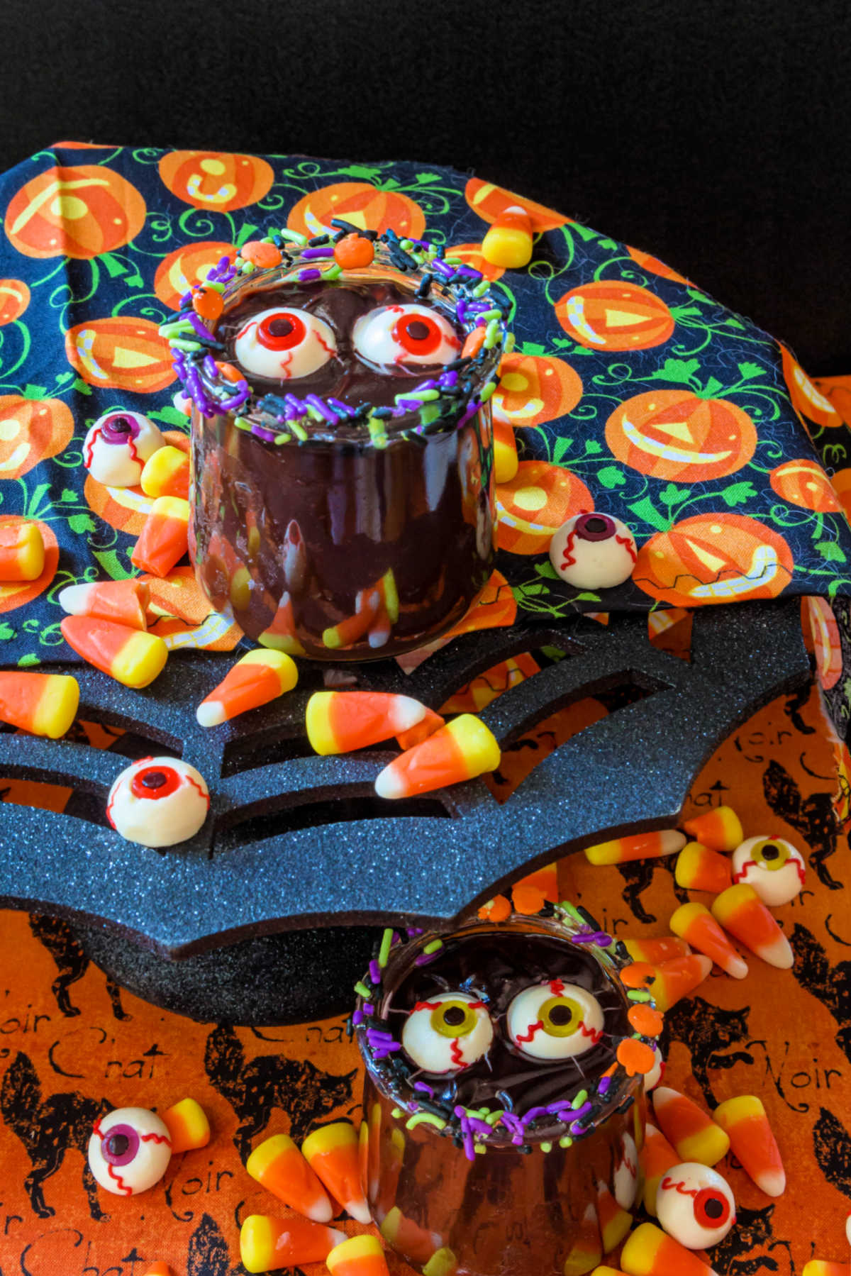 2 jars of easy chocolate pudding decorated for Halloween